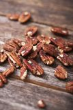 Pecans on Wood Royalty Free Stock Images
