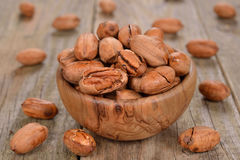 Pecans in a wooden bowl Royalty Free Stock Images