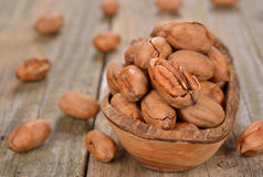 Pecans in a wooden bowl Royalty Free Stock Photo