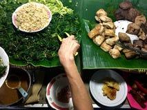 Pecel är en populär gatamat i Java, Indonesien Royaltyfria Bilder
