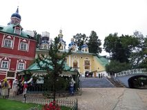 Pechora. Pskov Caves Monastery. Main square and Holy Dormition cathedrals. Stock Images
