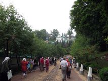 Pechora. Pskov Caves Monastery. Pilgrims coming in for ceremony. stock photography