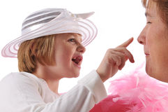 Pecial needs girl. Special needs girl with mother playing isolated against a white background royalty free stock images