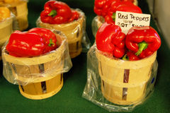Peck of Peppers. Baskets of red peppers are for sale at a farm stand Royalty Free Stock Photo