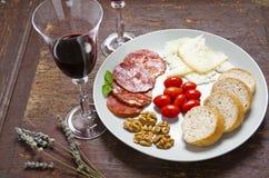 Pecorino乳酪用梨和果酱 意大利开胃菜 免版税库存照片