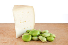 Pecorino cheese and broad beans. Cutting board with pecorino cheese and broad beans isolated on white background with clipping path Stock Photography