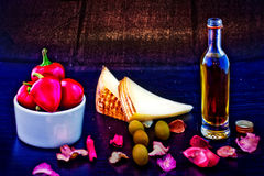 Pecorino cheese, olive oil and red peppers Stock Photos