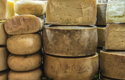 Pecorino cheese of Sardinia exposed for sale on a local market in Italy Stock Photo