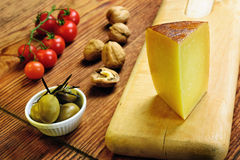 Pecorino toscano, italian sheep cheese, typical of Tuscany. On a old wooden table Stock Images