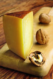 Pecorino toscano, italian sheep cheese, typical of Tuscany. On a old wooden table royalty free stock photography