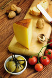 Pecorino toscano, italian sheep cheese, typical of Tuscany. On a old wooden table Royalty Free Stock Images