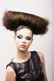 Peculiar Emotional Girl with Odd Creative Styling. Fantastic Hairdo. High Fashion Stock Photography