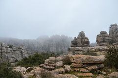 Limestone formations covered in fog. Peculiar limestone formations in the El Torcal de Antequera national park in Southern Spain Stock Photo