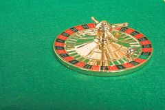 Peculiar roulette on green felt Stock Photo