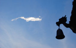 A peculiar shaped dragon cloud Stock Photo