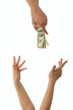 Pecuniary aid. Woman hands trying to  reach money Royalty Free Stock Photos