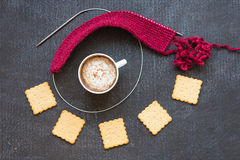 Ped knitting, cup of coffee and crackers Stock Photography