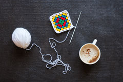 Ped knitting, cup of coffee and crackers Royalty Free Stock Photography