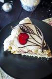 Pedaço de bolo no ano novo Foto de Stock