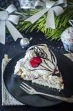 Pedaço de bolo no ano novo Imagem de Stock Royalty Free