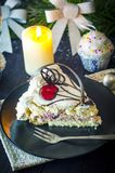 Pedaço de bolo no ano novo Imagem de Stock