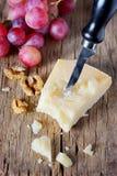 Pedaço do padano- de Grana do queijo parmesão imagem de stock royalty free