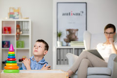 Pedagogue observes boy sick of Haller`s syndrome royalty free stock image