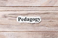 PEDAGOGY of the word on paper. concept. Words of PEDAGOGY on a wooden background.  Stock Photography