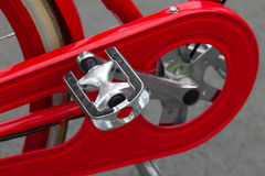 Pedal. Close-up of pedal with mudguards on red bicycle Royalty Free Stock Photography