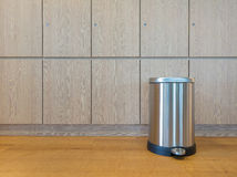 Pedal bin on wooden floor Royalty Free Stock Photography