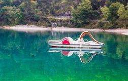 Pedal boat abandoned on the lake Stock Photos