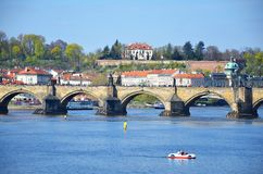 Pedal boat and Charles bridge, Prague Royalty Free Stock Image
