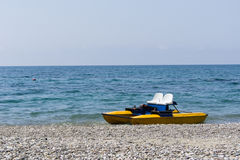 Pedal Boat on Sea Shore Stock Photos