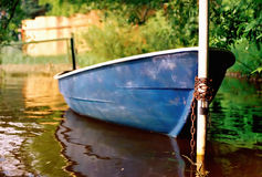 Pedal-boat, tied to a post. Stock Photos
