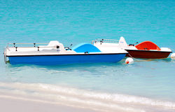 Pedal boats in the beach Stock Photo