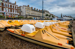 Pedal Boats on the Beach. Pedal Boats lined up on the beach, ready for hire, at the start of the day Royalty Free Stock Photography