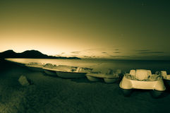 Pedal boats on the beach at night. Stock Photography