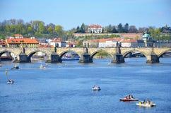 Pedal boats and Charles bridge, Prague Royalty Free Stock Photo