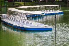 Pedal Boats locked at Peaceful Lake Marina. Recreation Equipment Royalty Free Stock Image