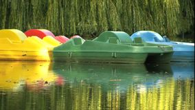 Pedal boats on a pond Stock Images