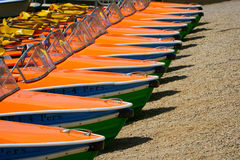 Pedal boats in a row at the shore Stock Photography