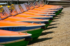 Pedal boats in a row Stock Image