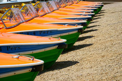 Pedal boats side by side on the shores Royalty Free Stock Images
