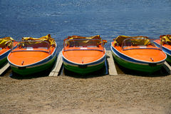 Pedal boats side by side on the shores Stock Images