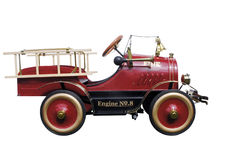 Pedal Car Fire Engine. Isolated with clipping path Stock Photo