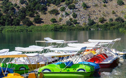 Pedal catamarans at coast of Cournas lake on Crete island Royalty Free Stock Images