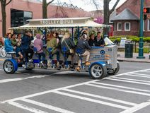 Pedal power moving bar with riders and bartender