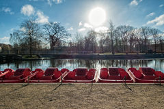 Pedal red punts in Odense river, Denmark. Pedal punts in Odense river, Denmark royalty free stock image