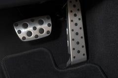Pedaler för krom för sportbil Arkivbild