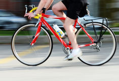 Pedalling Fast. Image of a cyclist pedalling Royalty Free Stock Photos